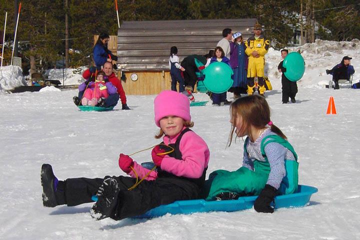 Vintage photo of children sledding at Snowplay